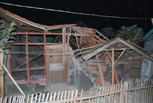 Examples of houses damaged by earthquakes